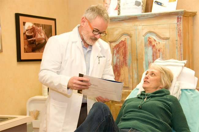 Dr. Norbertus Robben in consultation with a patient at his Havertown and South Philadelphia aesthetic medical practice